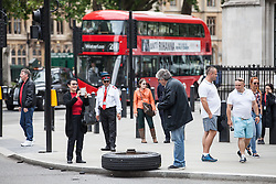 © Licensed to London News Pictures. 19/06/2016. London, UK. A wheel is left on the side of Parliament Square after it fell off the iconic London Duck Tours amphibious vehicle. Photo credit: Rob Pinney/LNP