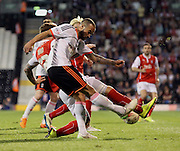 Ashley Richards trying to clear but getting pressured by Rotherham during the Sky Bet Championship match between Fulham and Rotherham United at Craven Cottage, London, England on 15 April 2015. Photo by Matthew Redman.