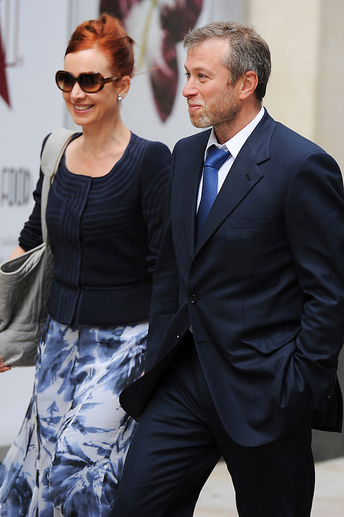 Chelsea Football Club Russian owner Roman Abramovich arrives at the Court of Appeal in Central London, with Karyl Nairn (L) Head of the arbitration division at Skadden Law firm on October 4, 2011. Chelsea Football Club owner Roman Abramovich was accused in a British court Monday of intimidating fellow Russian tycoon Boris Berezovsky into selling him oil company shares at a large discount. Berezovsky, who lives in exile in Britain, accuses Abramovich of breach of trust and breach of contract over the sale of shares in Russian oil company Sibneft, his lawyer told London's High Court at the opening of a trial. The trial continues today.....