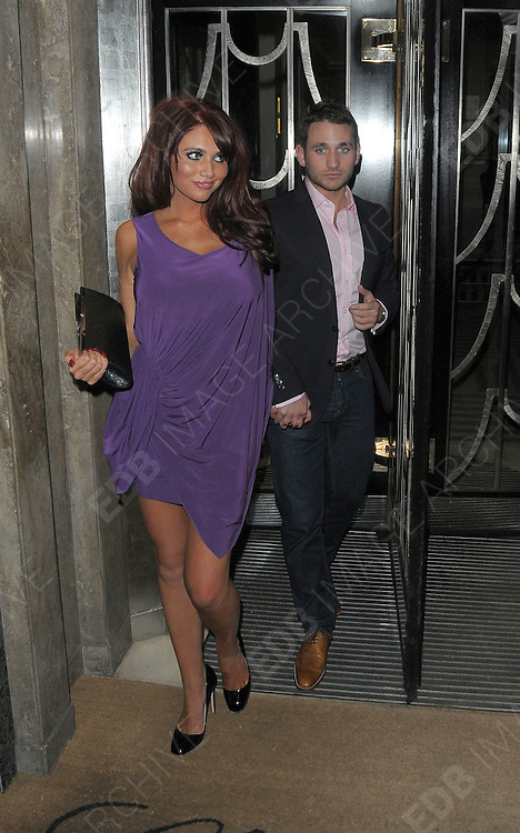02.APRIL.2011. LONDON<br /> <br /> THE ONLY WAY IS ESSEX STAR AMY CHILDS LEAVING CLARIDGES WITH HER BOYFRIEND JOE IN CENTRAL LONDON<br /> <br /> BYLINE: EDBIMAGEARCHIVE.COM<br /> <br /> *THIS IMAGE IS STRICTLY FOR UK NEWSPAPERS AND MAGAZINES ONLY*<br /> *FOR WORLD WIDE SALES AND WEB USE PLEASE CONTACT EDBIMAGEARCHIVE - 0208 954 5968*
