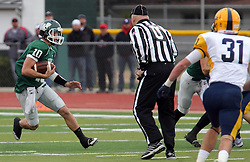 18 October 2014:  Donovan Laible runs approaching Umpire Pete Mixon during an NCAA division 3 football game between the Augustana Vikings and the Illinois Wesleyan Titans in Tucci Stadium on Wilder Field, Bloomington IL