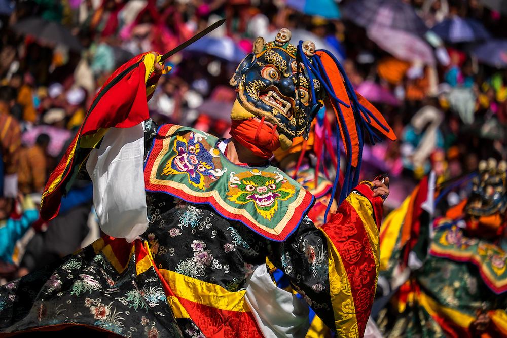 THIMPU, BHUTAN - CIRCA OCTOBER 2014: Mask performer dancing during the Tshechu Festival inl Bhutan