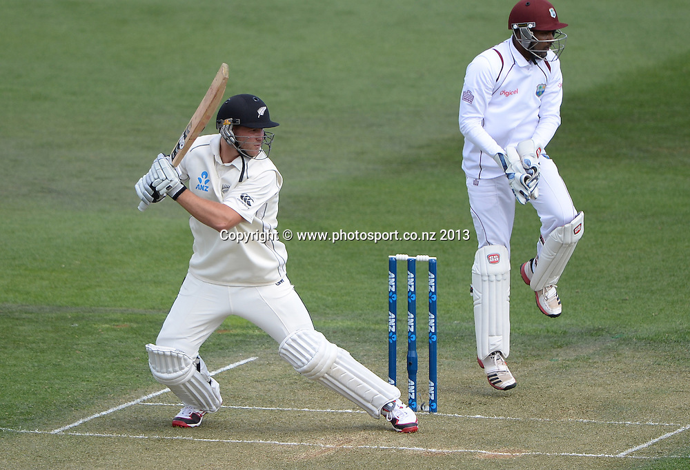 Corey Anderson batting as Denesh Ramdin looks on during play Day 1 of the 2nd cricket test match of the ANZ Test Series. New Zealand Black Caps v West Indies at The Basin Reserve in Wellington. Wednesday 11 December 2013. Mandatory Photo Credit: Andrew Cornaga www.Photosport.co.nz