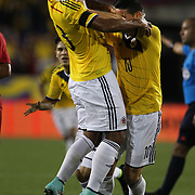James Rodriguez, Colombia, pushes away team mate Freddy Guarín after scoring the winning goal during the Columbia Vs Canada friendly international football match at Red Bull Arena, Harrison, New Jersey. USA. 14th October 2014. Photo Tim Clayton