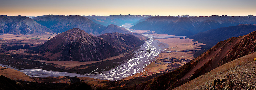 Wide view of the braided Waimakariri River at dusk, looking west from Mt Binser. Canterbury, New Zealand