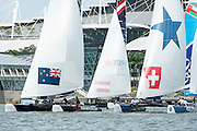 Emirates Team New Zealand competeing in day one of the Extreme Sailing Series regatta being sailed in Singapore. 20/2/2014