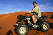 "CC Africa Afro Ventures' luxurious ""Andersson's Africa"" Safari. Sunrise excursion with ATVs (All Terrain Vehicles) to the dunes south of CC Africa's Sossusvlei Mountain Lodge. Heimo Aga riding an ATV."
