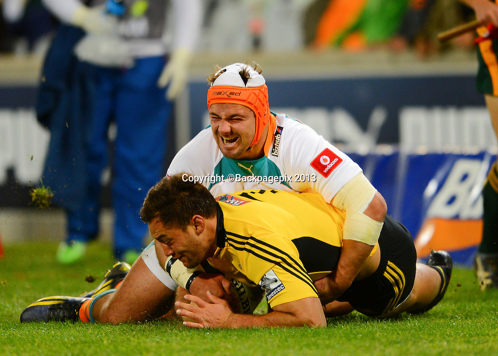 Heinrich Brussow of the Cheetahs tackles Jack Lam of the Hurricanes during the Super Rugby match between the Cheetahs and the Hurricanes at the Free State Stadium in Bloemfontein on May 10, 2013©Barry Aldworth/BackpagePix