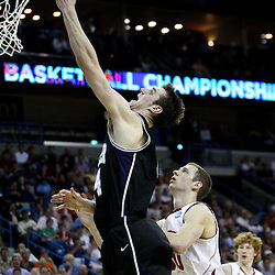 Mar 24, 2011; New Orleans, LA; Butler Bulldogs center Andrew Smith (44) shoots over Wisconsin Badgers forward Jon Leuer (30) during the first half of the semifinals of the southeast regional of the 2011 NCAA men's basketball tournament at New Orleans Arena.  Mandatory Credit: Derick E. Hingle
