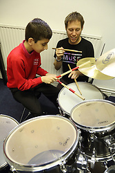 Visually impaired boy being given drumming lessons at My Sight charity, Nottingham.