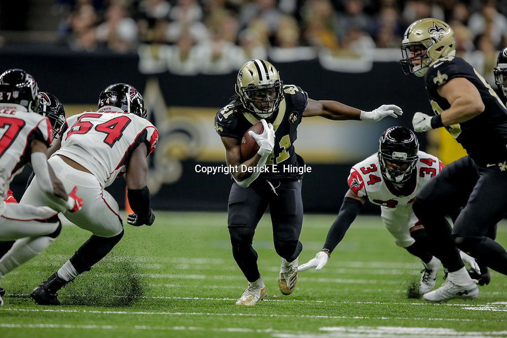 Nov 22, 2018; New Orleans, LA, USA; New Orleans Saints running back Alvin Kamara (41) runs between Atlanta Falcons cornerback Brian Poole (34) and linebacker Foye Oluokun (54) during the third quarter at the Mercedes-Benz Superdome. Mandatory Credit: Derick E. Hingle-USA TODAY Sports