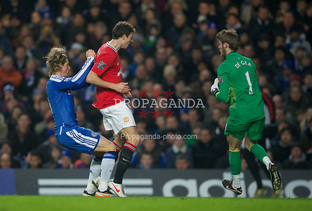 LONDON, ENGLAND - Sunday, February 5, 2012: Chelsea's Fernando Torres clatters into Manchester United's Jonny Evans, and was shown the yellow card as a result, during the Premiership match at Stamford Bridge. (Pic by David Rawcliffe/Propaganda)