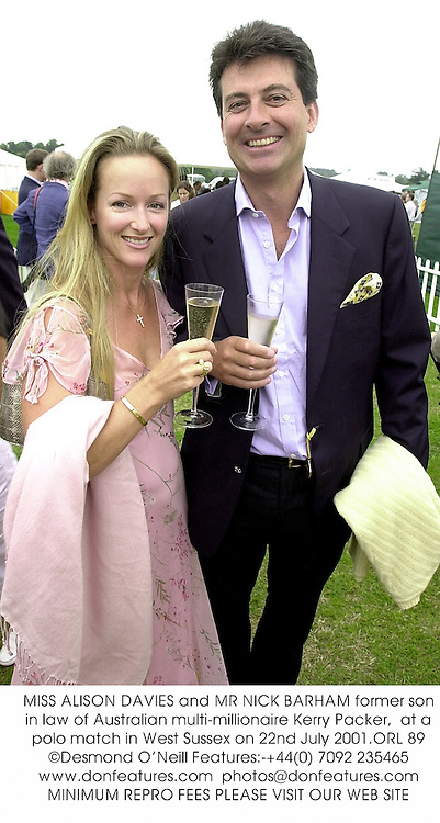 MISS ALISON DAVIES and MR NICK BARHAM former son in law of Australian multi-millionaire Kerry Packer,  at a polo match in West Sussex on 22nd July 2001.ORL 89