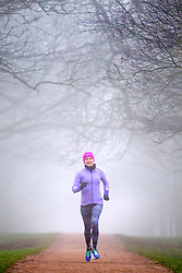 © Licensed to London News Pictures. 07/02/2020. Leeds UK. A lady runs through Temple Newsam park in the fog in Leeds, Yorkshire this morning. Photo credit: Andrew McCaren/LNP