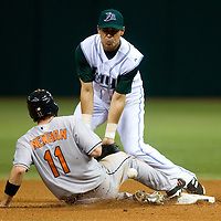 Baltimore Orioles David Newhan (C) is hit by the ball on the throw to Tampa Bay Devil Rays second baseman Tomas Perez by Devil Ray catcher Toby Hall during a pickoff attempt in the third inning at Tropicana Field in St. Petersburg, Florida on April 10, 2006. REUTERS/Scott Audette