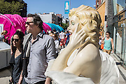 People pass a mannequin of Marilyn Monroe on the Bowery as they attend the Ideas City street festival.