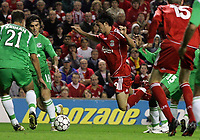 Photo: Paul Thomas.<br /> Liverpool v Maccabi Haifa. UEFA Champions League Qualifier. 09/08/2006.<br /> <br /> Luis Garcia of Liverpool (C) is judged top have dived rather than than been fouled by Xavir Dirceo in the penalty box.
