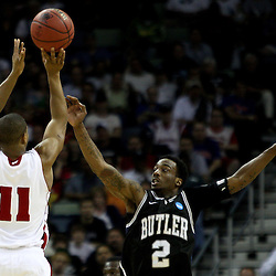 Mar 24, 2011; New Orleans, LA; Wisconsin Badgers guard Jordan Taylor (11) shoots over Butler Bulldogs guard Shawn Vanzant (2) during the first half of the semifinals of the southeast regional of the 2011 NCAA men's basketball tournament at New Orleans Arena.  Mandatory Credit: Derick E. Hingle
