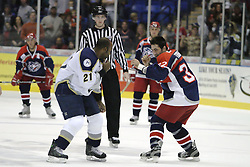 11 November 2006: PraireThunder's Jason Payne and Jackals Curtis Tidball decide a boxing match would be a quicker method to choose a winner.  They go at it for about a dozen punches at center ice before getting a respite in the penalty box..The Elmira Jackals met the Bloomington PrairieThunder at the U.S. Cellular Coliseum in Bloomington Illinois.<br />