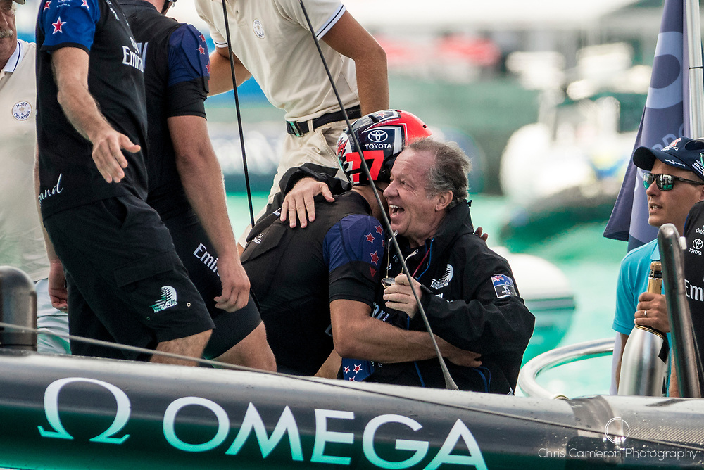 The Great Sound, Bermuda, 26th June 2017. Emirates Team New Zealand Principal Matteo de Nora gets a hug from Blair Tuke after the final race of the 35th America's Cup.