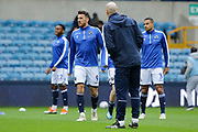 Millwall defender James Meredith (3) Millwall striker Lee Gregory (9) and Millwall defender Mahlon Romeo (12) warming up before the EFL Sky Bet Championship match between Millwall and Ipswich Town at The Den, London, England on 27 October 2018.