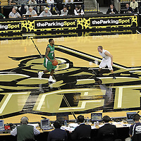 Marshall guard Johnny Higgins (4) pushes the ball up past Central Florida guard A.J. Rompza (3) during a Conference USA NCAA basketball game between the Marshall Thundering Herd and the Central Florida Knights at the UCF Arena on January 5, 2011 in Orlando, Florida. Central Florida won the game 65-58 and extended their record to 14-0.  (AP Photo/Alex Menendez)