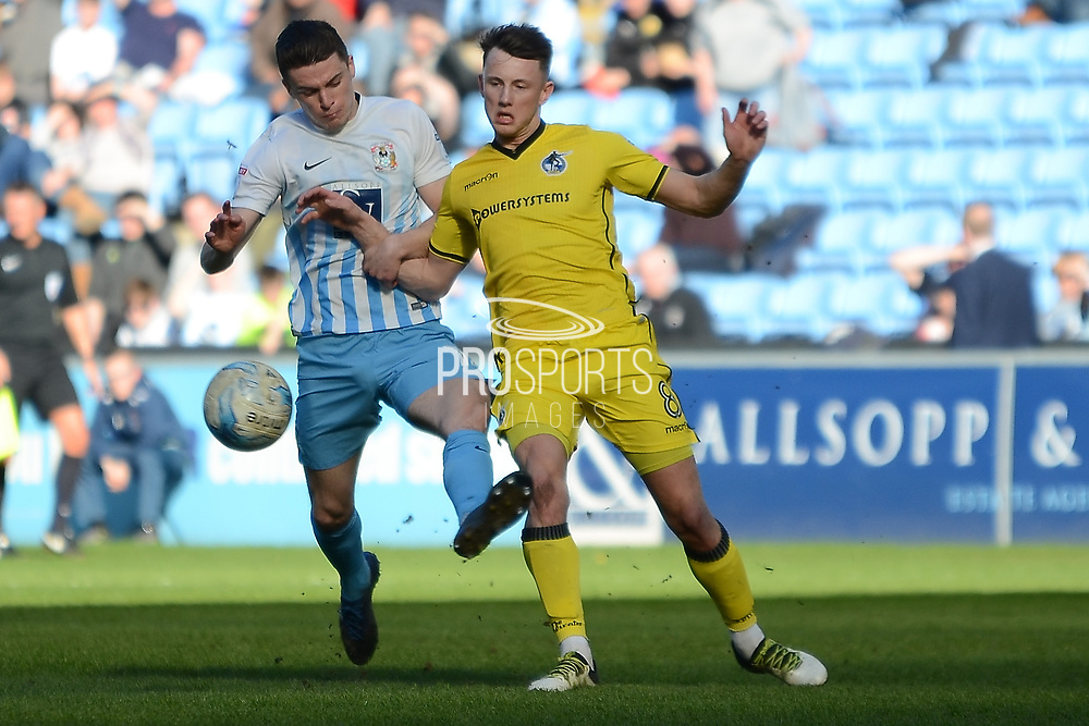 Coventry City midfielder Callum Reilly (12) and Bristol Rovers midfielder Ollie Clarke (8) battle for the ball 0-0 during the EFL Sky Bet League 1 match between Coventry City and Bristol Rovers at the Ricoh Arena, Coventry, England on 25 March 2017. Photo by Alan Franklin.