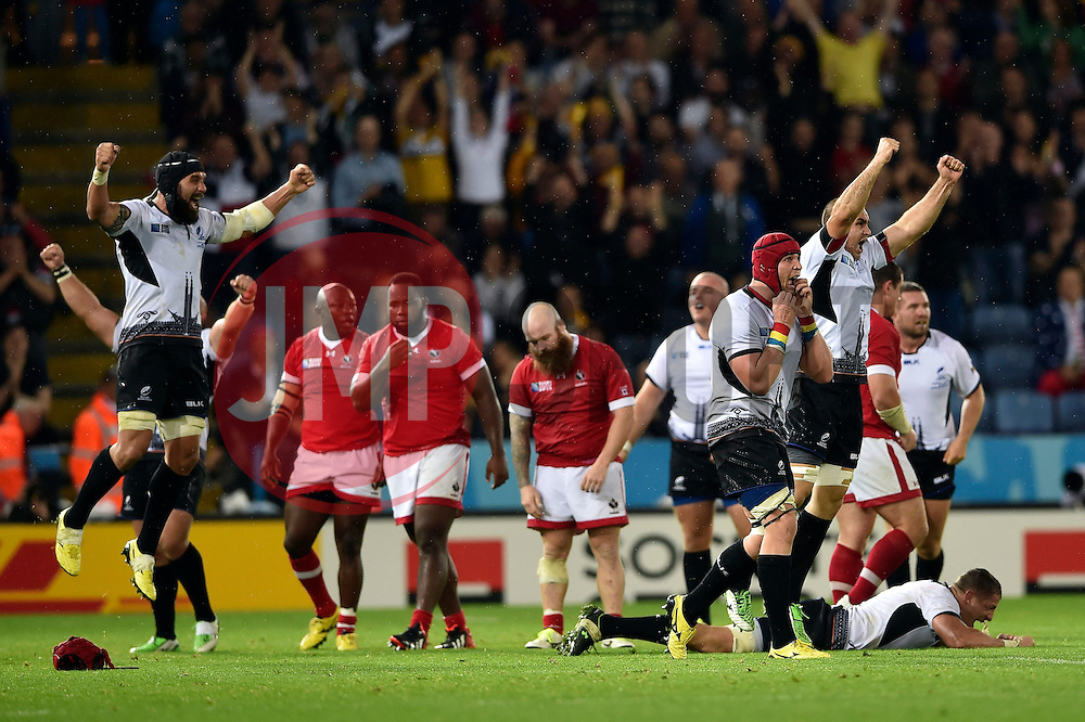 The Romania team celebrate at the final whistle - Mandatory byline: Patrick Khachfe/JMP - 07966 386802 - 06/10/2015 - RUGBY UNION - Leicester City Stadium - Leicester, England - Canada v Romania - Rugby World Cup 2015 Pool D.