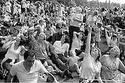 Watching the free fall parachute display. 1983 Yorkshire Miner's Gala. Barnsley