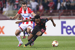 Nenad Krsticic of Crvena Zvezda vs Joseph Willock of Arsenal during football match between NK Crvena Zvezda Beograd and Arsenal FC in Group H of UEFA Europa League 2017/18, on October 19, 2017 in Stadion Rajko Mitic, Belgrade, Serbia. Photo by Marko Metlas / Sportida