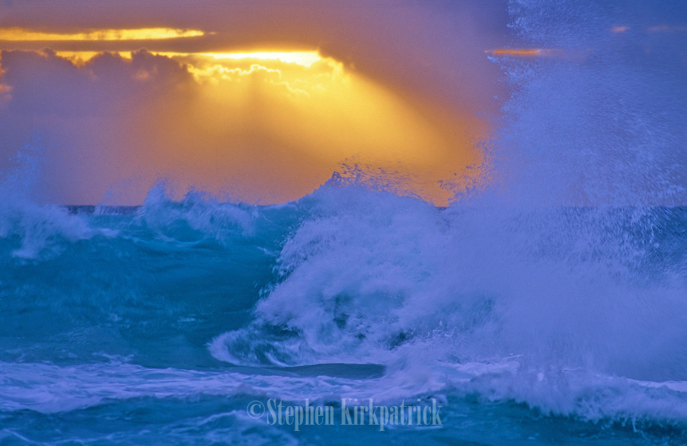 "A stormy sunrise seen from Halona Cove, the beach where the risque love seen with Burt Lancaster and Deborah Kerr in ""From Here to Eternity"" was filmed in the 1950's - Oahu, Hawaii."