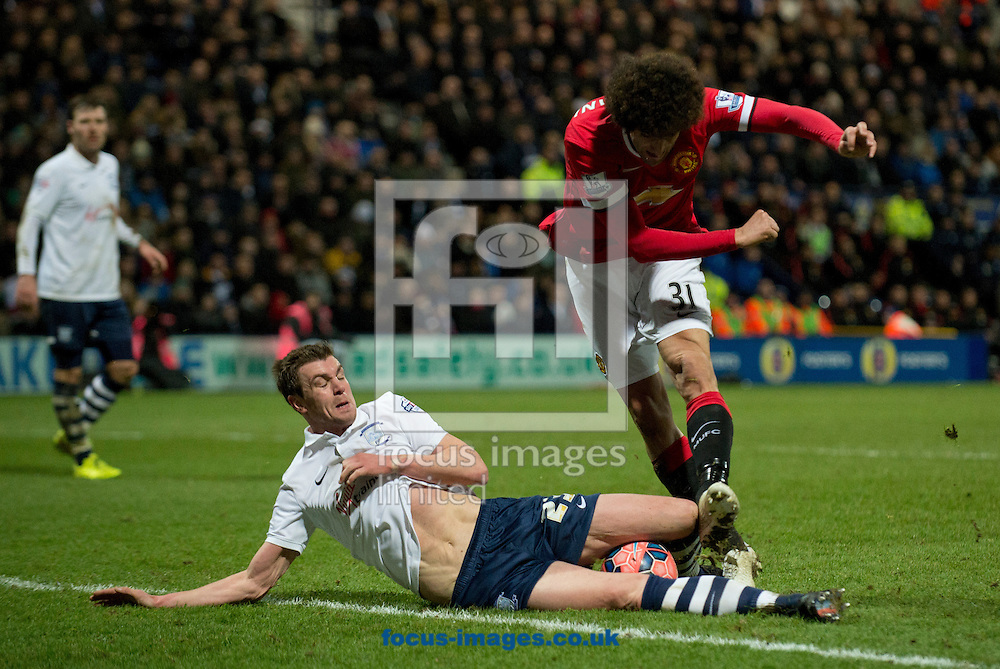 Paul Huntington of Preston North End blocks a shot by Marouane Fellaini of Manchester United during the FA Cup match at Deepdale, Preston<br /> Picture by Russell Hart/Focus Images Ltd 07791 688 420<br /> 16/02/2015