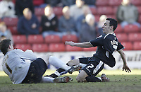 Photo: Aidan Ellis.<br /> Barnsley v Swansea City. Coca Cola League 1. 04/03/2006.<br /> Swansea's Leon Britton comes close but is kept out by Barnsley keeper Nick Colgan