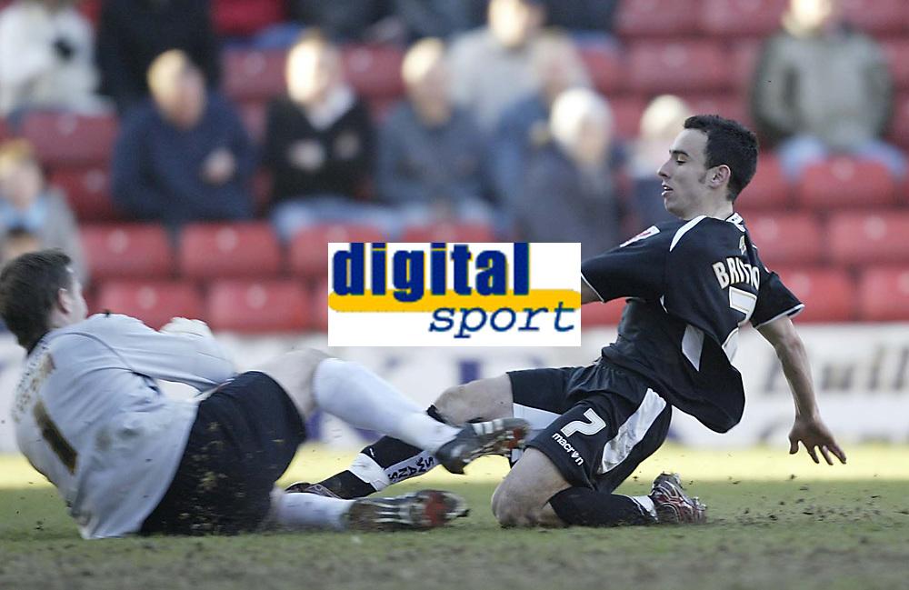 Photo: Aidan Ellis.<br /> Barnsley v Swansea City. Coca Cola League 1. 04/03/2006.<br /> Swansea's Leon Britton comes close but is kept out by Barnsley keeper Nick Colgan