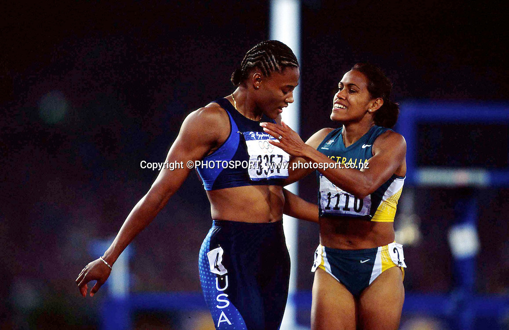 Marion Jones (USA) and Cathy Freeman celebrate after the Women's 200m Final at the Sydney Olympic Games, on September 28 2000. Photo: PHOTOSPORT<br />