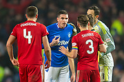 Kyle Lafferty (#11) of Rangers FC argues with Andy Considine (#4) and Graeme Shinnie (#3) of Aberdeen FC during the Ladbrokes Scottish Premiership match between Rangers and Aberdeen at Ibrox, Glasgow, Scotland on 5 December 2018.