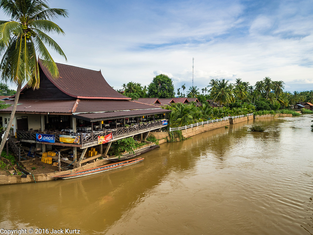 17 JUNE 2016 - DON KHONE, CHAMPASAK, LAOS: Restaurants overlooking the Mekong River on Don Khon. Don Khon Island, one of the larger islands in the 4,000 Islands chain on the Mekong River in southern Laos. The island has become a backpacker hot spot, there are lots of guest houses and small restaurants on the north end of the island.        PHOTO BY JACK KURTZ
