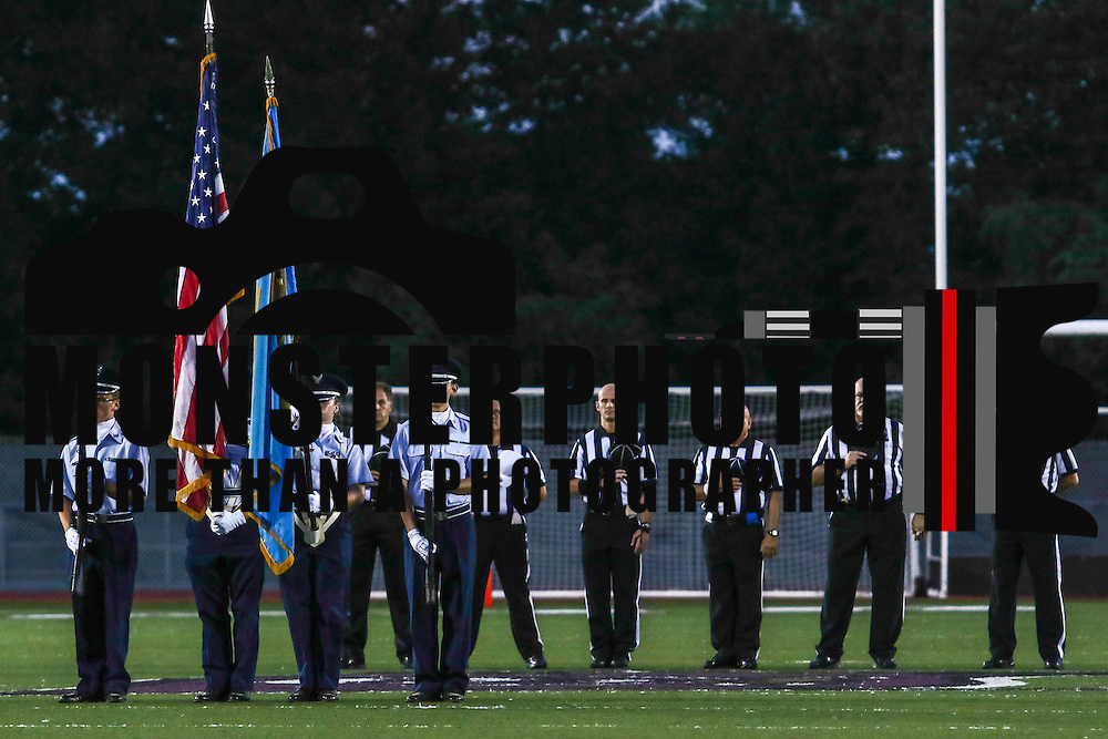 Color guard and referees stand at attention during the national anthem prior to a week one DIAA game between  William Penn and St. Georges, Friday, Sept. 09, 2016 at CARAVEL Academy in Bear, DE.