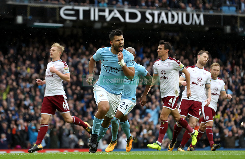 "Manchester City's Sergio Aguero celebrates scoring his side's first goal from the penalty spot, equaling Manchester City's all-time scoring record during the Premier League match at the Etihad Stadium, Manchester. PRESS ASSOCIATION Photo. Picture date: Saturday October 21, 2017. See PA story SOCCER Man City. Photo credit should read: Martin Rickett/PA Wire. RESTRICTIONS: EDITORIAL USE ONLY No use with unauthorised audio, video, data, fixture lists, club/league logos or ""live"" services. Online in-match use limited to 75 images, no video emulation. No use in betting, games or single club/league/player publications."