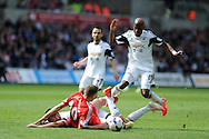 Southampton 's  Sam Gallagher is sent flying by Swansea's Jordi Amat and Dwight Tiendalli &reg;. Barclays Premier league match, Swansea city v Southampton at the Liberty stadium in Swansea, South Wales on Saturday 3rd May 2014.<br /> pic by Andrew Orchard, Andrew Orchard sports photography.