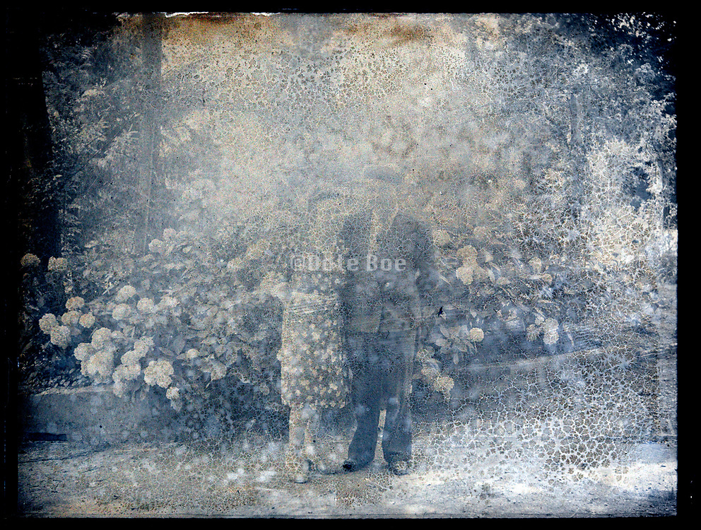 severely deteriorating emulsion photo with couple posing France circa 1920s