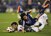Khaled Muftah of Qatar fouls Shinji Kagawa of Japan