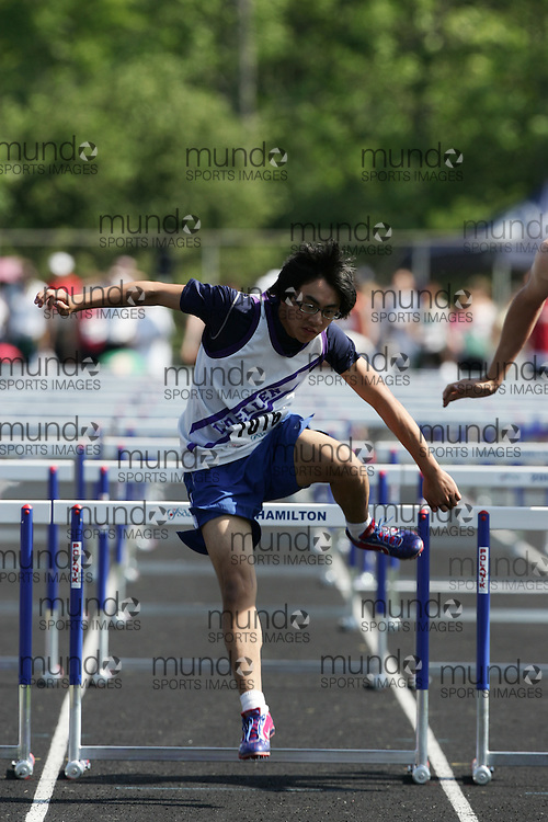 Hamilton, Ontario ---06/06/08--- Ben Kim of LoinEllen Park in Sudbury competes in the sprint hurdles at the 2008 OFSAA Track and Field meet in Hamilton, Ontario..
