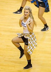 Mar 2, 2016; Morgantown, WV, USA; A West Virginia Mountaineers dance team member performs during the first half against the Texas Tech Red Raiders at the WVU Coliseum. Mandatory Credit: Ben Queen-USA TODAY Sports