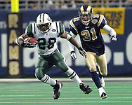 New York Jets running back Curtis Martin (28) runs past St. Louis Rams strong safety Adam Archuleta (31) for a first down, during the first half at the Edward Jones Dome in St. Louis, Missouri, January 2, 2005.  The Rams beat the Jets in overtime 32-29.