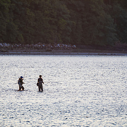 Two women fishing in Casco Bay near Martin Point in Portland, Maine.