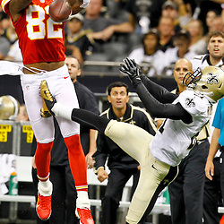 September 23, 2012; New Orleans, LA, USA; Kansas City Chiefs wide receiver Dwayne Bowe (82) drops a pass as New Orleans Saints cornerback Patrick Robinson (21) defends during overtime of a game at the Mercedes-Benz Superdome. The Chiefs defeated the Saints 27-24 in overtime. Mandatory Credit: Derick E. Hingle-US PRESSWIRE