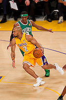 17 June 2010: Guard Derek Fisher of the Los Angeles Lakers drives to the basket while being defended by Rajon Rondo of the Boston Celtics during the first half of the Lakers 83-79 championship victory over the Celtics in Game 7 of the NBA Finals at the STAPLES Center in Los Angeles, CA.