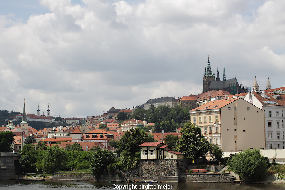 A view across Moldau in Prague, with the view of the Hrdancy Palace in the background