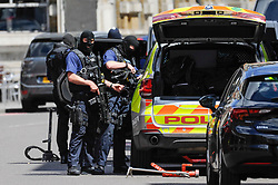 © Licensed to London News Pictures. 04/06/2017. London, UK. Heavily armed policemen are seen on Borough High Street after the previous night's terrorist attack where a reported three attackers were shot by the police and seven members of the public died after being attacked with knives.  Photo credit : Stephen Chung/LNP